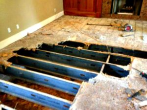 Sub-flooring that has rotted due to moisture problems.